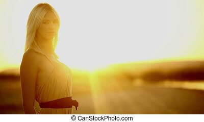 Young girl seductive blonde woman portrait sunset silhouette...