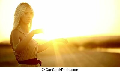 Young seductive girl blonde woman portrait sunset silhouette...