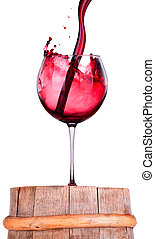 Glass of red wine on a wooden barrel - Glass of red wine on...