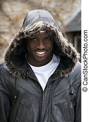 Portrait of Happy Young Man - Happy young man with his hood...
