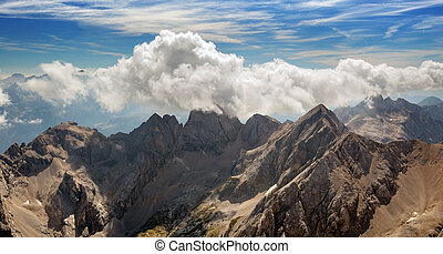 alpine massif - panoramic view of a mountain range in the...