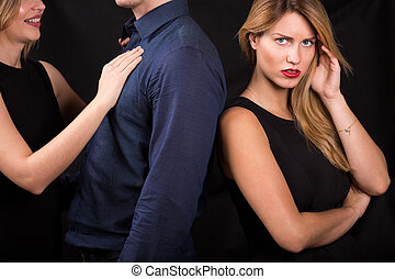 Man betraying his girlfriend with other woman