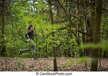 Active runner exercising in nature