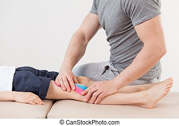 Physical therapist doing massage - Close up of physical...