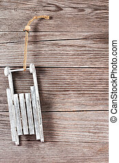 sledge hanging on a wooden wall - gray sledge hanging on a...