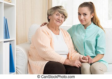 Senior woman and carer in rest home