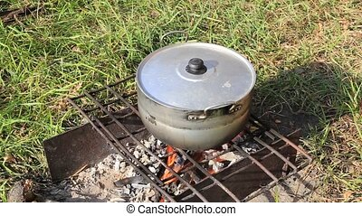 Healthy food outdoors - The pot was set to fire to cook fish...