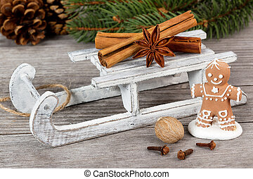 gingerbread man and spices on wooden sled