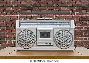 Vintage Boombox on Table with Red Brick Wall - Vintage...