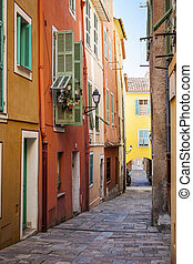 Bright houses on old street in Villefranche-sur-Mer - Row of...