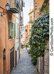 Old street in Villefranche-sur-Mer - Narrow cobblestone...