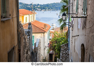 Old street in Villefranche-sur-Mer - Narrow street with old...