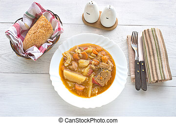 Chicken stew with potatoes in plate
