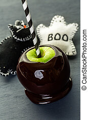 Black candy apples - Homemade candy apples on black...
