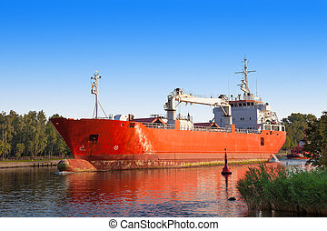 Cargo ship with tug boat - Cargo ship out of the port of...
