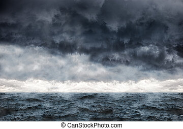Sea in a storm - Dark clouds in the winter sky during a...