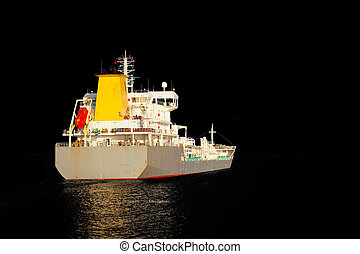 Ship silhouette - Photo of a tanker ship isolated on black...