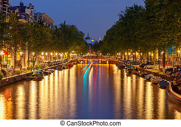 Embankment and canal of Amsterdam at night - View of the...