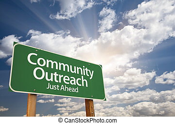 Community Outreach Green Road Sign Over Clouds - Community...