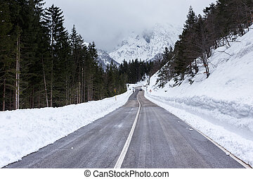 Empty mountain road on a cloudy winter day Italy
