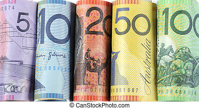 Rolls of Australian cash money with five, ten, twenty, fifty and one hundred dollar notes.