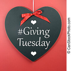 Giving Tuesday message greeting on black heart shape...