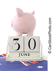 End of Financial Year Savings Concept with piggy bank and...