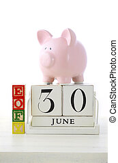 End of Financial Year Savings Concept with piggy bank, EOFY...
