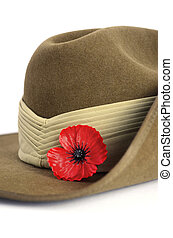 Anzac Day army slouch hat with red poppy on white background...