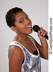 Black woman with a microphone