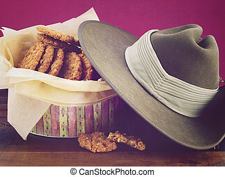 Australian Anzac biscuits in vintage biscuit tin with army...
