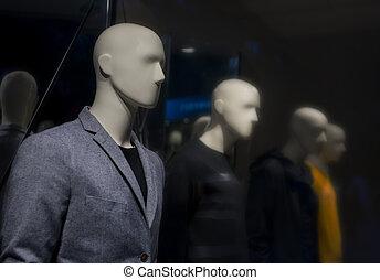 male dummies - Row of male dummies in shop window