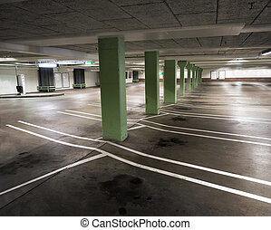 indoor carpark - Interior from empty indoor carpark with oil...