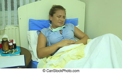 Woman having abdominal pain