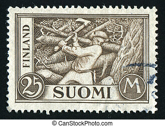 postmark - FINLAND - CIRCA 1930: Young man is chopping wood,...