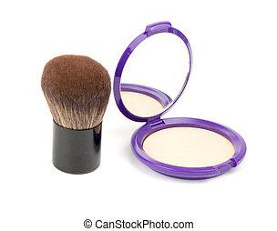 Face powder with kabuki brush