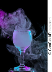 Purple smoke in a glass. Halloween. - Abstract art. Purple...