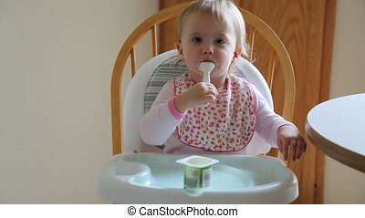 Yogurt - High chair is a piece of furniture used for feeding...