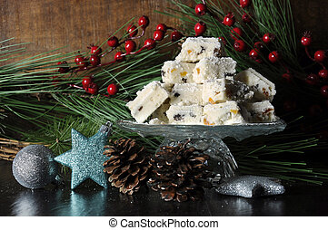Christmas holiday traditional White Christmas confectionery chocolate against dark wood rustic background.