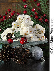Christmas holiday traditional White Christmas confectionery chocolate against dark wood rustic background. Vertical.