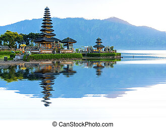 Pura Ulun Danu temple panorama at sunrise on a lake Bratan,...