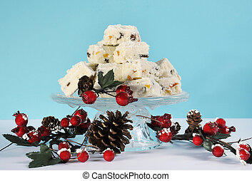 Christmas holiday traditional White Christmas confectionery chocolate against pale blue and white background.