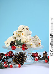 Christmas holiday traditional White Christmas confectionery chocolate against pale blue and white background. Vertical.