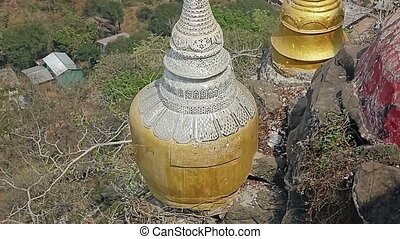 Votive stupas at Taungkalat monastery atop an outcrop of...