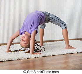 smiling little girl  engaged in fitness