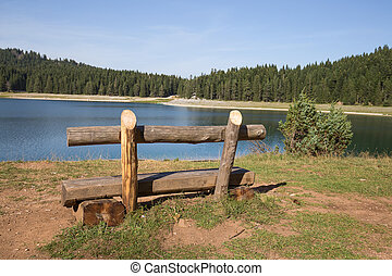 Bench near lake Beautiful mystical lake Black Lake, Durmitor...