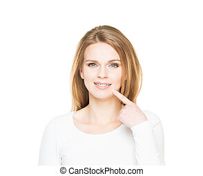 Attractive teenage girl smiling in teeth retainer...