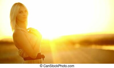Young seductive blonde girl woman portrait sunset silhouette...