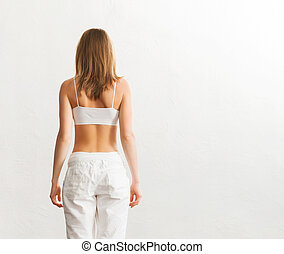 Back of young fit woman