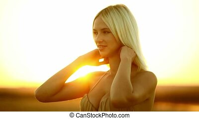 Young sexy seductive girl portrait woman on sunset yellow...